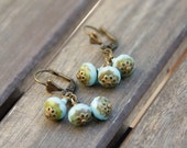 DIABOLO earrings • Brass earrings with turquoise glass faceted beads