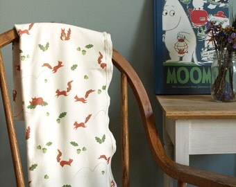 Woodlands Baby Blanket with Red Squirrels and Green Acorns in Organic Jersey Cotton