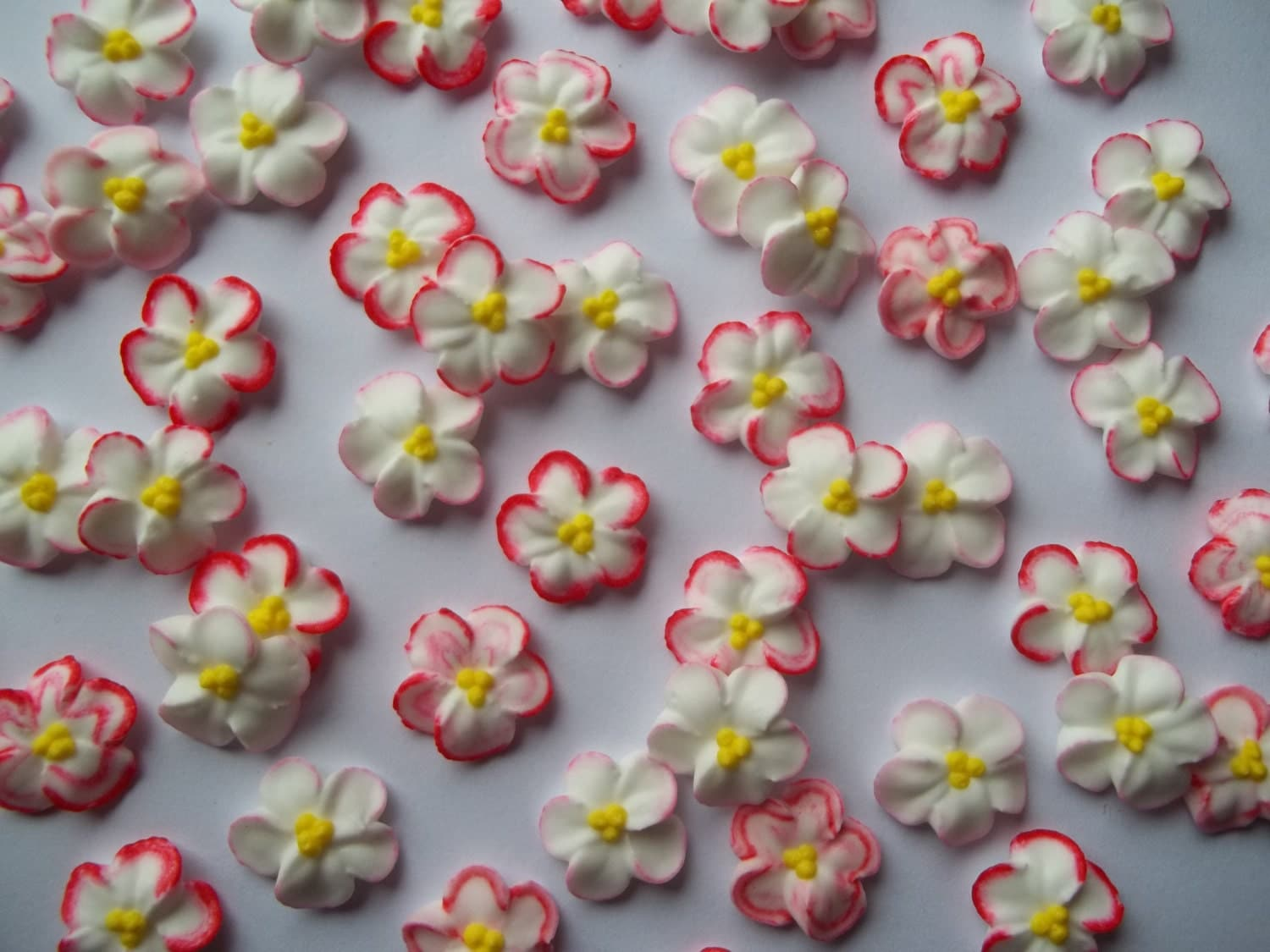Red-tipped white royal icing flowers by SweetSarahsBoutique