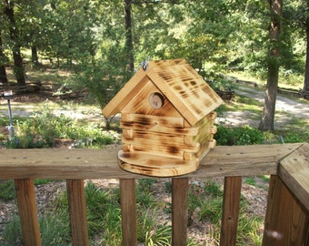 Log Cabin style Bird House made for THE BIRDS with vented sides, perch, porch, removable bottom, and overhanging front roof.