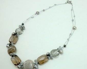 Smoky quartz,crystal,freshwater pearl hand knotted on silk necklace.