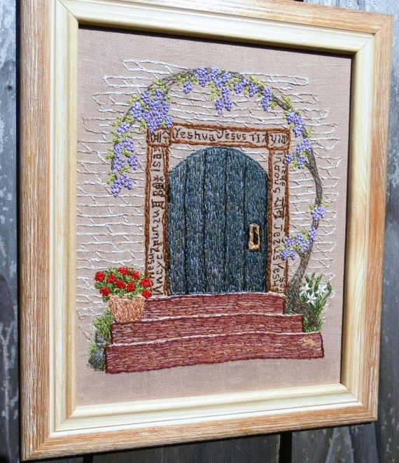 Hand embroidered  illustration picture of door with languages and purple wisteria