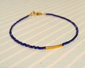 Blue Beaded Bracelet with Gold Tube Charm