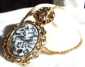 Moss agate pendant, black and white in gold tone filigree setting