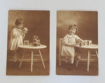 Two Vintage Sepia Photographs of Young Girl Playing with Toys - 1920/1930s