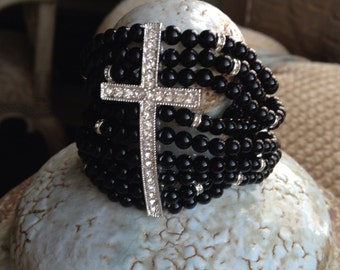 9 strand black onyx beaded cuff bracelet with crystal rhondel pieces and crystal cross.