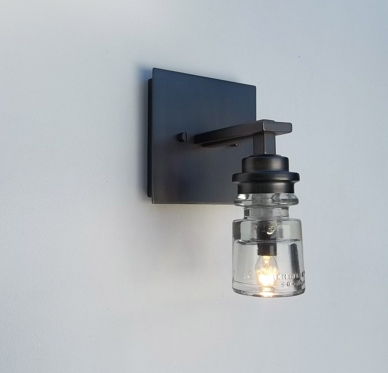 clear glass insulator wall light fixture by cre8iveconcrete. Black Bedroom Furniture Sets. Home Design Ideas