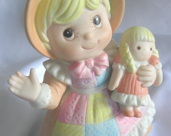 Little Girl with Patchwork Apron and Doll Figurine - Marked HOMCO Logo - Vintage 1980s