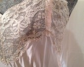 Vintage peachy-pink silk slip with beige colored lace