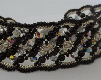 Swarovski crystals and glass pearls bracelet .