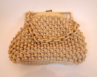 Vintage 60s Mod style beige crotchet and bead hand bag with plastic close and plastic chain strap