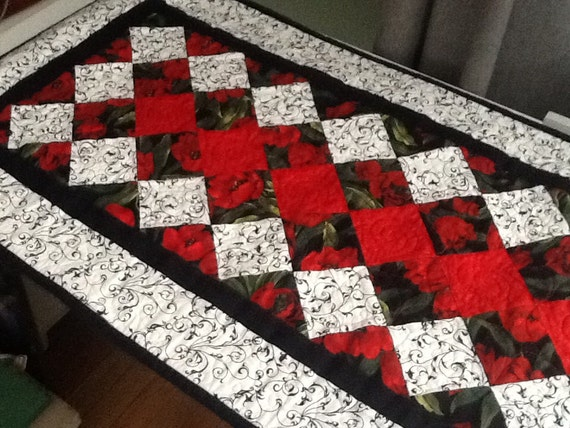 Black, white and red table runner