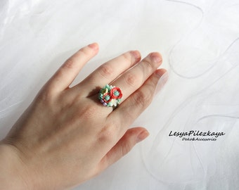 Ring of polymer clay with small flowers - white-red-yellow-green - in a brass frame - floral ring