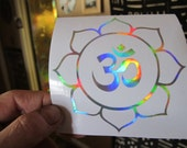 "OM In Lotus. Sticker. Decal.  Prismatic.  Prismatic Rainbow Silver vinyl. 3.75"" size."