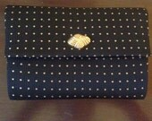 vintage black and gold textured clutch