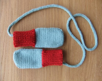 Hand knitted light teal and scarlet baby mittens with knitted string - available to order in sizes 0-3, 3-6 and 6-12 months