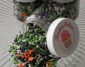 Fright Night Sprinkle Mix-Comes in an assortment of pumpkin and bat sprinkles and white, purple and green jimmies.