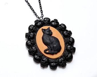 Black cat on orange cameo in skull frame