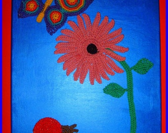 Crocheted gerbera flower, snail and butterfly on painted canvas