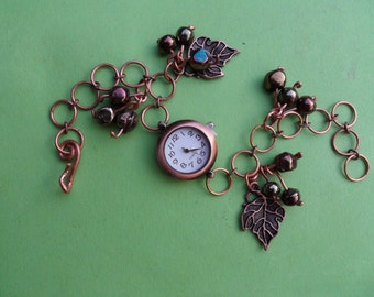 Bracelet watch copper antique style jewellery grapes and vine leaves.