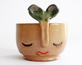 Soft brown smiling vase with green flower- wheel thrown, handmade ceramics, one of a kind vase
