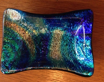 Small fused dichroic glass dish.  Striking colors. Works as a support spindle bowl.
