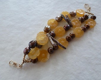 juicy yellow jade flowers bronze pearls biwa pearls gold beads; three strands hooked together makes Golden Glow Bracelet