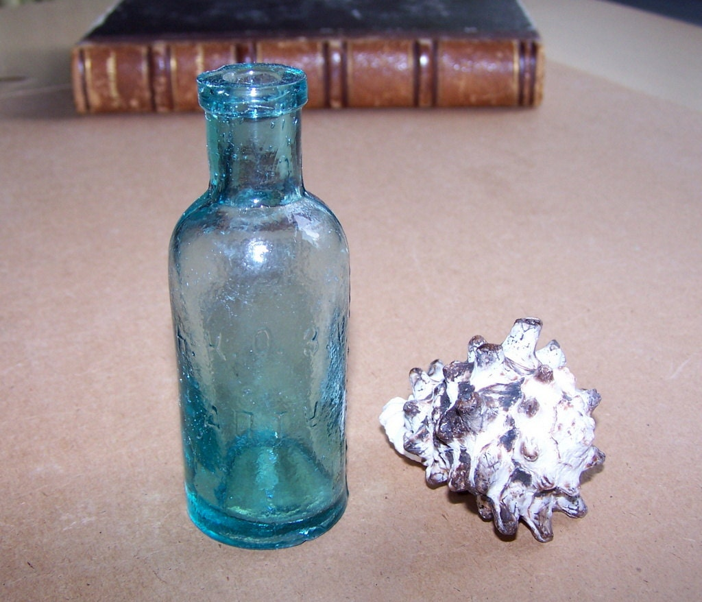 Old blue glass bottle for medicine laboratory use home photo for Uses for old glass bottles