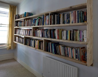 Mammoth! reclaimed wooden wall sized Library sized bookcase.
