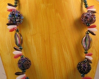 beaded bead necklace in gold, pink and purple