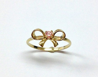 14k gold Bow Ring with stone.