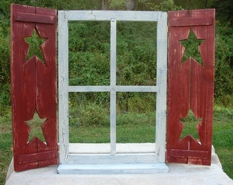 """Window with hinged shutters and shelf, stars in shutters 31-1/2"""""""" wide 24-1/2"""" high"""