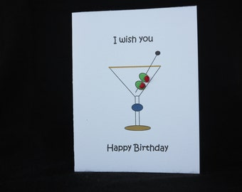 "Birthday card with martini glass and two olives with red knots.  The inside reads, ""with olive my heart."""