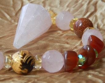 ROSE QARTZ PENDULUM.Can be used as a Healing pendulum and Divination pendulum.