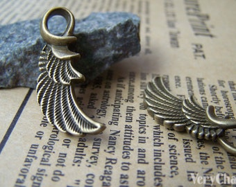10 pcs of Antique Bronze Feather Wing Charms Pendants 10x32mm A3233