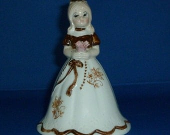 Porcelain Bell Young Lady in Long Gown Holding Pink Flower