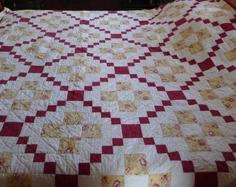 Handquilted King size quilt in a nine-patch design patchwork