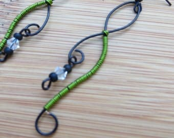 Black earrings wrapped in green wire