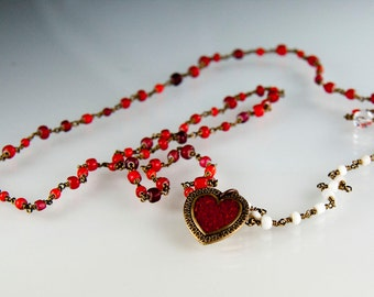 Corazon Necklace - Vintage African white heart beads, Swarovski crystal and a bronze heart inlaid with red coral