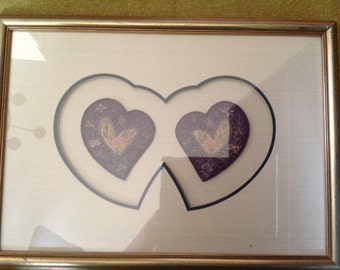 frame and matted embroidered and stitched pr. of silk hearts with Asian feel