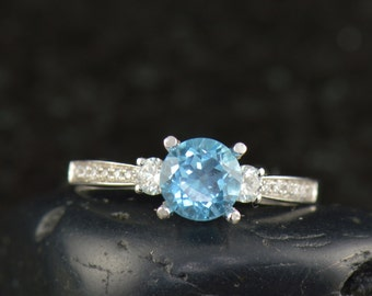 Diana - Blue Topaz and Dimond Engagement Ring in White Gold, Round Center, 3-Stone Design with Closed Baskets, Classic Style, Free Shipping