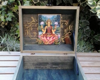 Green box with God Lakshmi and OM