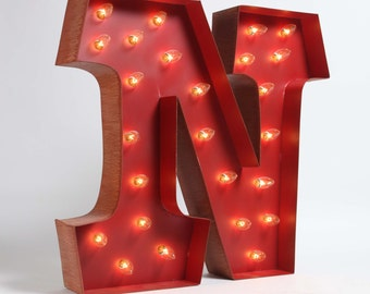 Awesome Whimsical lighted carousel letter N.  includes lights, a teeny assembly process.  safe for outdoor or indoor use!