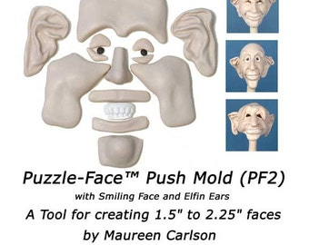 PF2 - Puzzle-Face Mold with Smiling face and Elfin Ears for creating clay faces by Maureen Carlson and Wee Folk Creations
