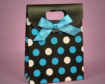3 Blue and white polka dot gift bags with handle.