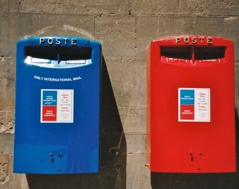 Colorful Red and Blue Poste Boxes in Florence, Italy.