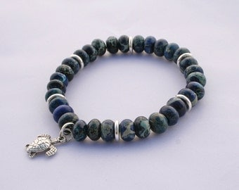 Blue Sea Sediment Rondelle Stretch Bracelet with Charm and silver accents