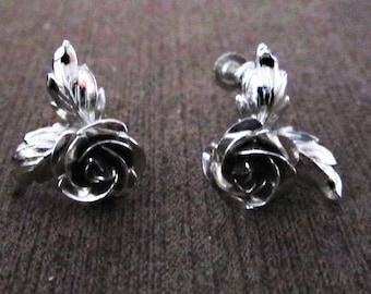 Vintage rose silver  screw back earrings.