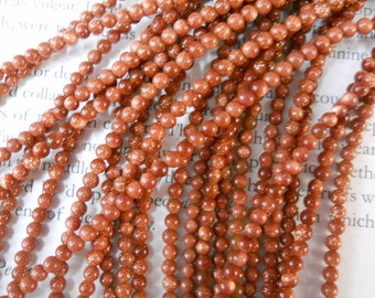 "3mm round sandstone beads, goldstone beads, 16"" strand long"