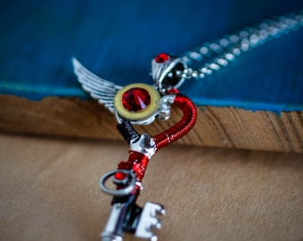 """Steampunk skeleton key pendant with watch parts, metal wire and crystals """"Ifrit"""" - Red & Silver"""